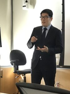 Youngee speaking during his defense